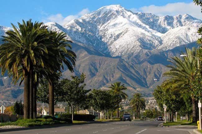 A view of Rancho Cucamonga, California with mountains in the background.